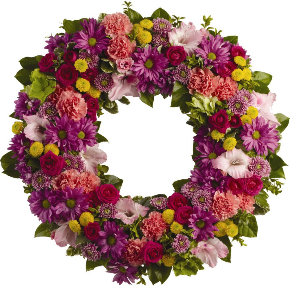 Colourful flower wreath for a funeral service.