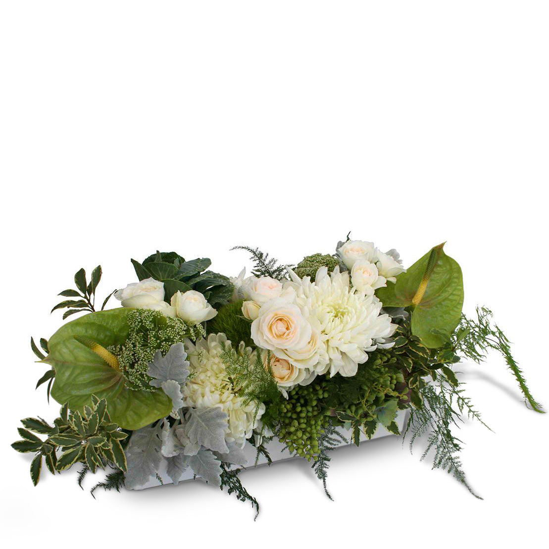 Seasonal Flowers in white designed into a ceramic vase in a long and low style.
