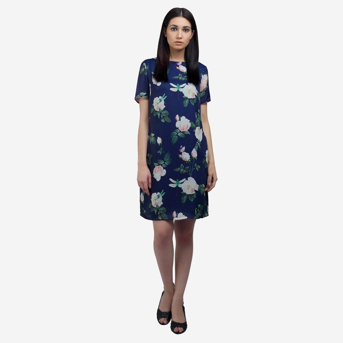 Printed blue silk knee length work and evening wear dress with side pockets and boat neck
