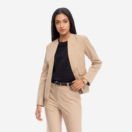 Beige Solid Single Breasted Tailored Formal Blazer with deep front pockets, full sleeves and falls at the hips.