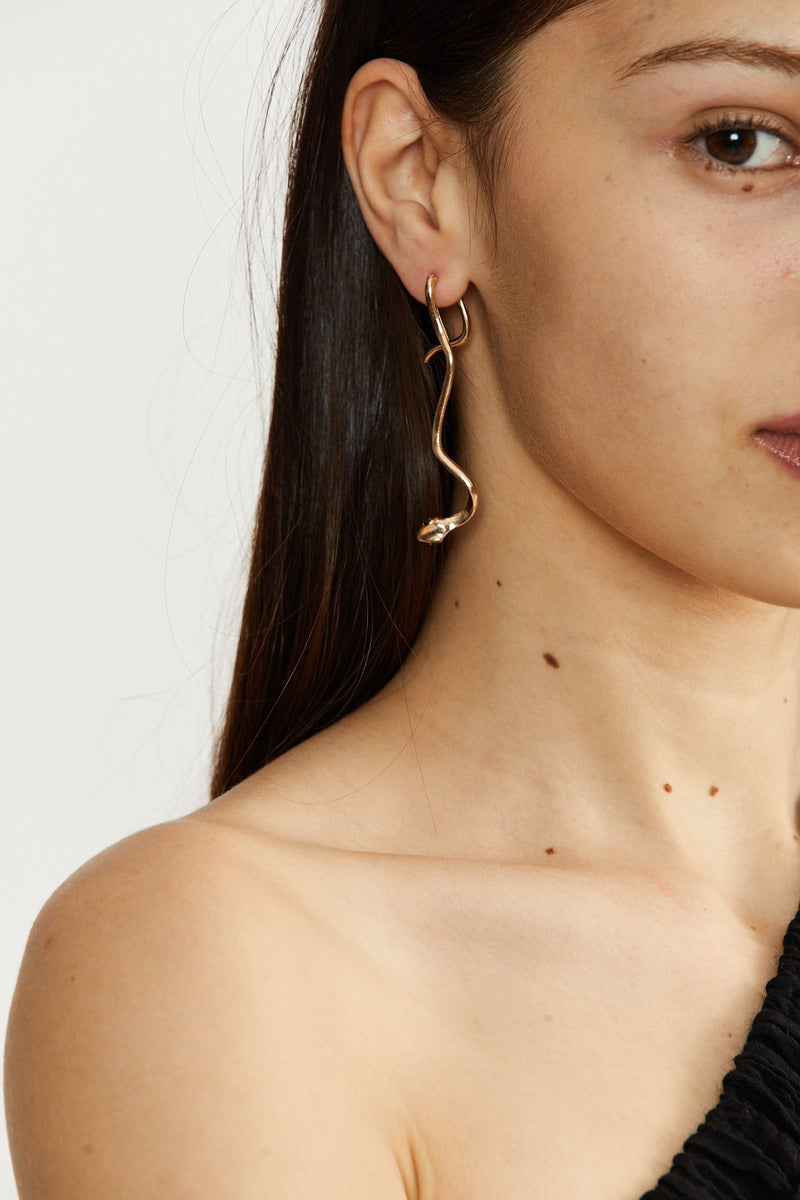 Turning heads snake statement earring