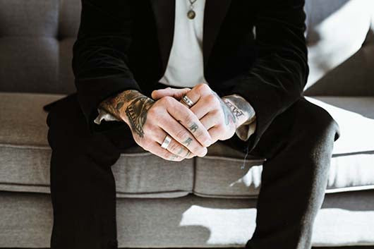 An man with Tattooed hands
