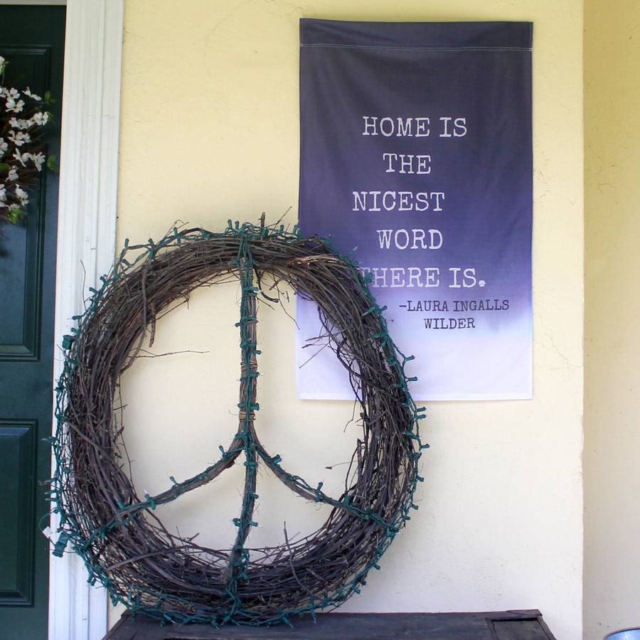 Home is the Nicest Word There Is Laura Ingalls Wilder Flag, Wall Hanging seen on front porch with peace sign