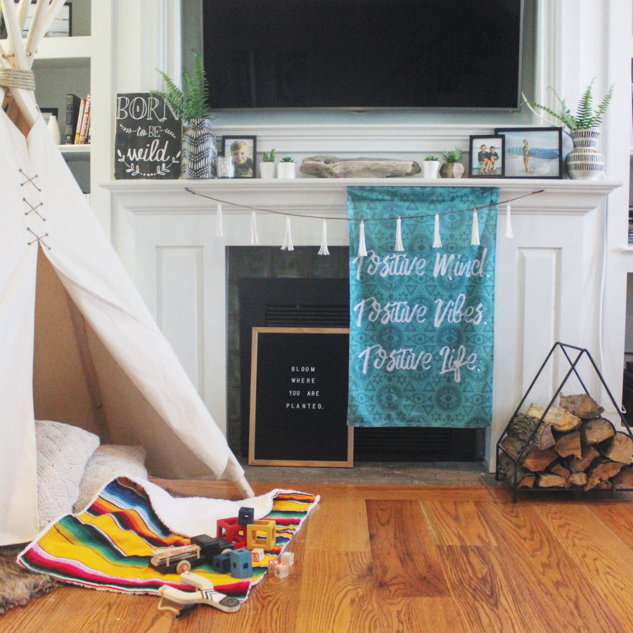 Positive Mind Positive Vibe Teal Wall Hanging in boho farmhouse living room, fireplace and kids teepee