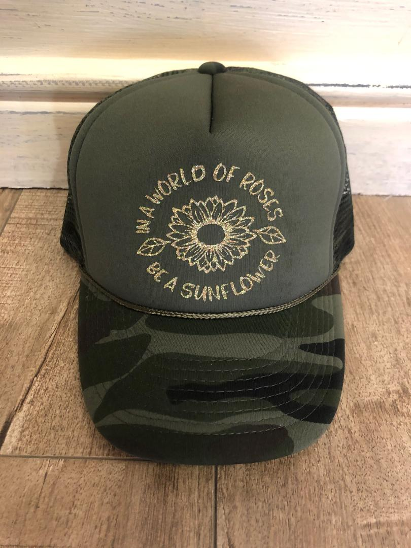 In a world of roses be a sunflower Trucker Hat