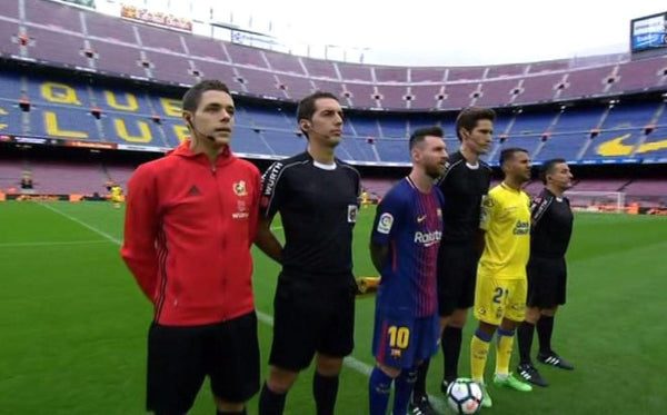 Barcelona players walk out to an empty Nou Camp with 98,000 fans stuck outside as home side wear Catalonia flag warm-up shirts