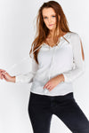 Scoop neck long sleeve top with jewelled studs and tie detail front