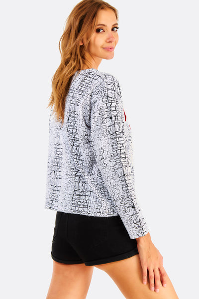 white patterned blouse with text print