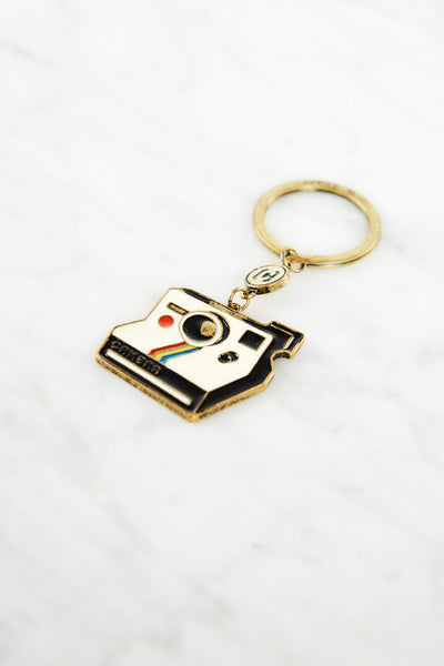 White Keychain With Camera Design