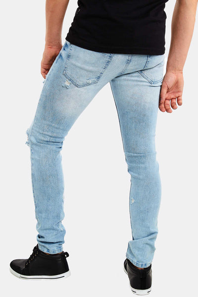 Light Blue Jeans With Rips