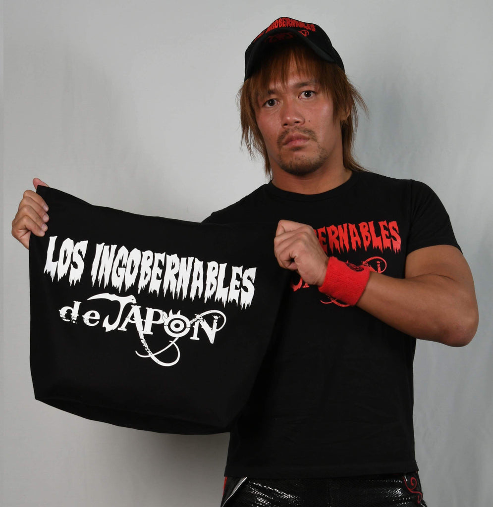 Former IWGP Heavyweight Champion Tetsuya Naito with Styled after New Japan Pro Wrestling's breifcase holding the rights to contend for the IWGP Heavyweight title at The Tokyo Dome on January 4th 2018.  That was won by the founder of Los Ingobernables de Japon, Tetsuya Naito at the 2017 G1 climax against The Cleaner Kenny Omega.