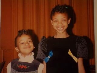 Alexandria Boddie, on the right, after her first piano recital with her sister April standing beside her.
