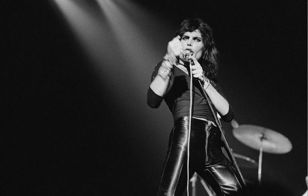 Freddie Mercury in concert. Photo by Michael Putland.