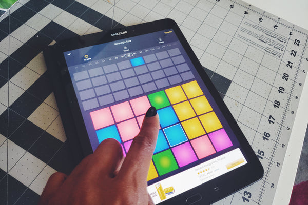 Alexandria Boddie uses DPM to make beats on her Samsung tablet.