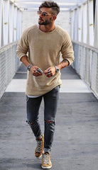Long fit streetwear tee with ripped jeans and high tops sneakers