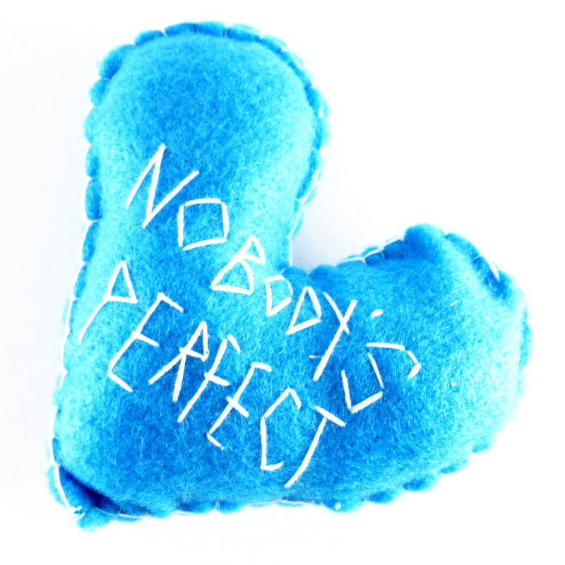 "Felt heart hand stitched with the words ""nobody's perfect"" by Annie Lou Studios"