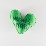 "Felt heart hand stitched with the words ""nobody's perfect""by Annie Lou Studios"