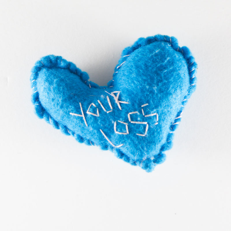 "Felt heart hand stitched with the word ""your loss"" by Annie Lou Studios"