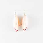 Clay Hand Earrings by Anjelica Colliard in clear with pink nails