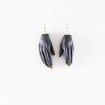 Clay Hand Earrings by Anjelica Colliard in black with gold nails