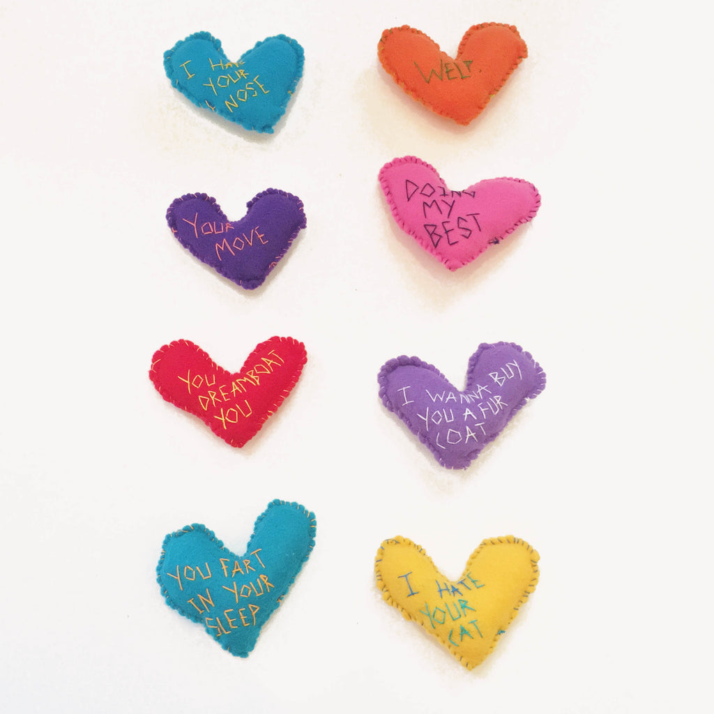 Variety of felt hearts hand stitched by Annie Lou Studios