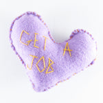 "Felt heart hand stitched with the words ""get a job""by Annie Lou Studios"