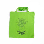 I'd Rather be talking to my plants tote bag by the glitter box girl gang in green