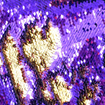 Mermaid color-changing sequin shorts by local New Orleans artist Jill Lindsay in purple and gold