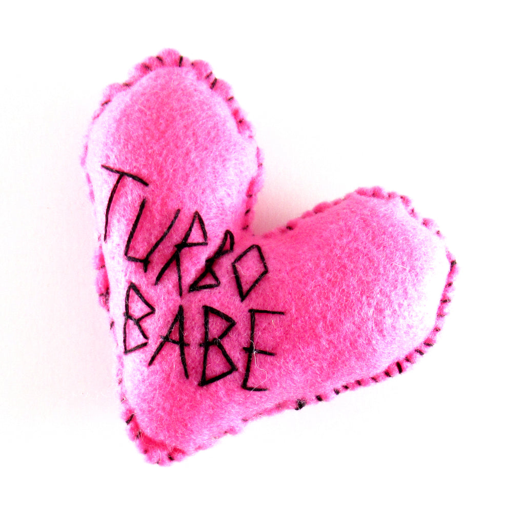 "Felt Heart Hand stitched with the words ""turbo babe"" by Annie Lou Studios"