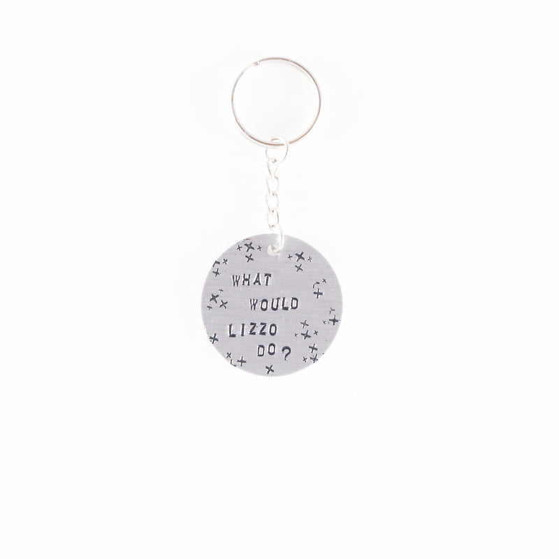 "Metal keychains hand stamped with ""what would lizzo do?"" by Mitzi Wear."