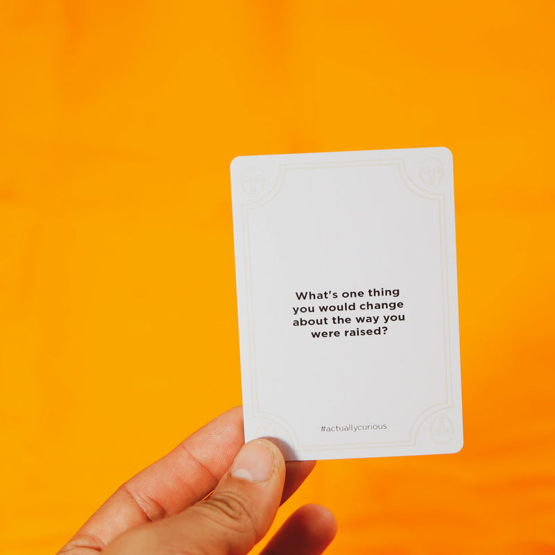 "Actually curios card with question ""what is one things you would change about the way you were raised?"""
