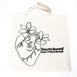 Sisterhood not cisterhood with heart and flower doodle designed by jillian desirée on canvas bag