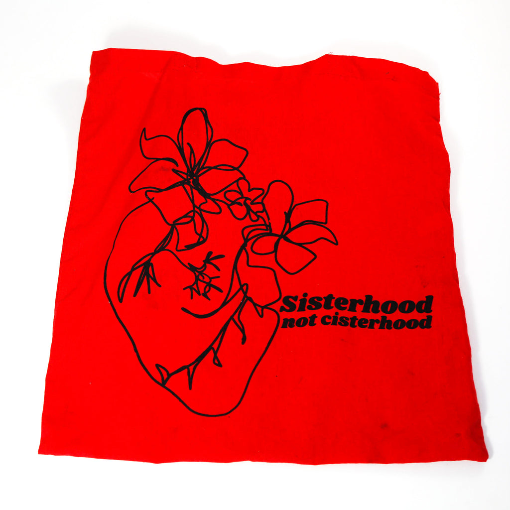 Sisterhood not cisterhood with heart and flower doodle designed by jillian desirée on red totebag