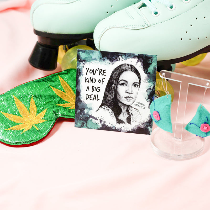 teal haireola earrings by hairy dena photographered alongside badass women valentines feat aoc, eye mask by sleephammer
