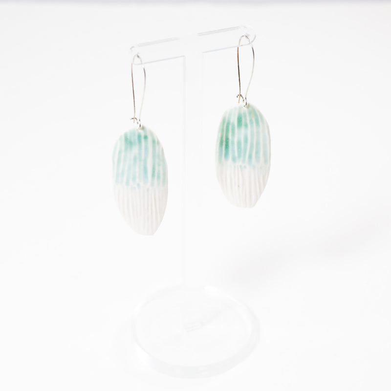 lightweight ceramic earrings by danny desire in light blue and white