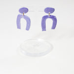 lightweight porcelain earrings by danny desire in arch style purple color