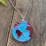International Women's Day Glitter Globe Necklace by PolyPaige. Pink and blue glitter globe pendant on a nickle free chain silver colored chain.