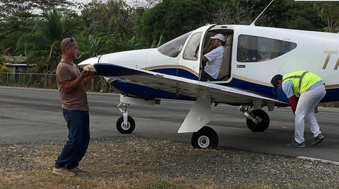 Small plane with a flat tire at Puerto Jimenez airport in Costa Rica