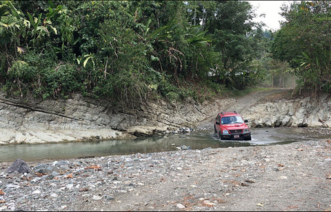 car fording the Rio Tigre in Costa Rica