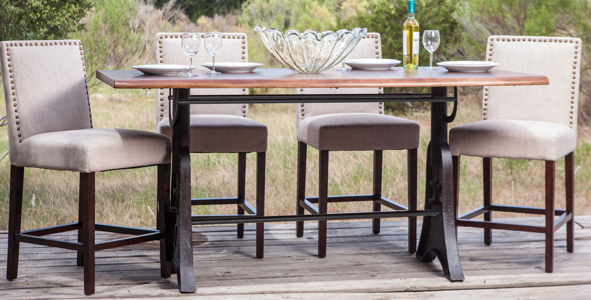irondale gathering table with jona chairs from world interiors austin texas hill country background