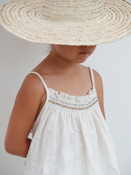 Organic cotton smock romper in natural