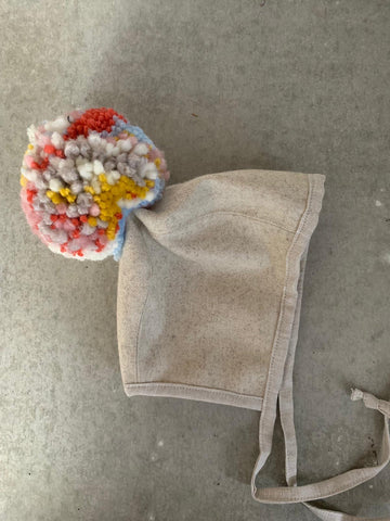 Oatmeal and Multi Pom brimless wool bonnet lined with merino wool