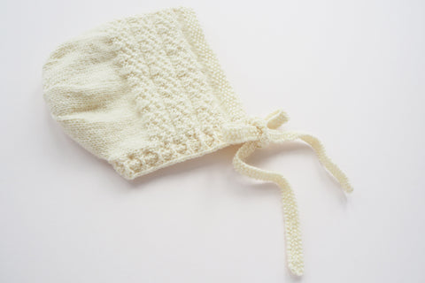Merino wool hand knitted bonnet in cream