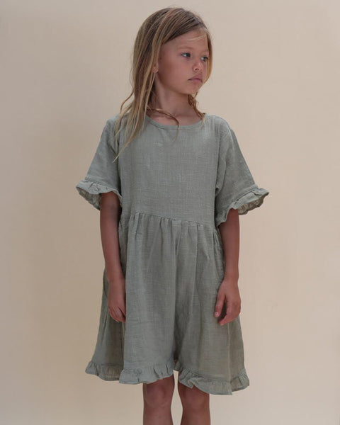 Frill dress in woven cotton in Elm