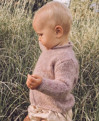 Hand knitted baby alpaca jumper in blush/lilac