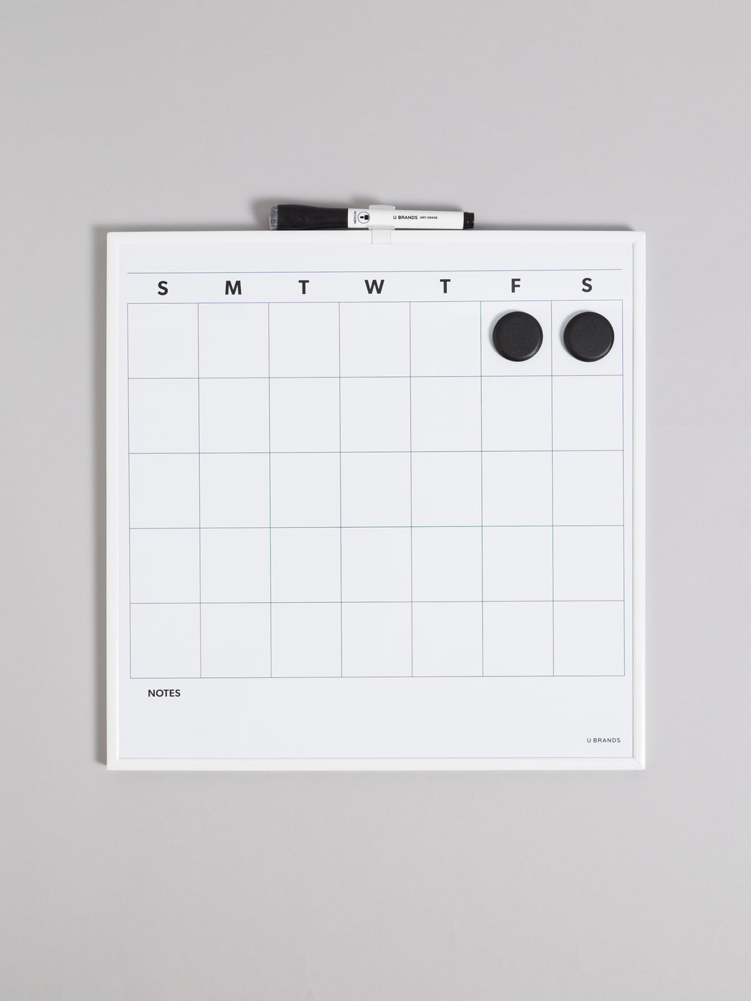 Aluminum/ metal framed squared dry erase calendar whiteboard. Included one bullet tip dry erase marker with a built-in felt eraser cap, one plastic marker clip to mount you marker directly to the board frame and two round black magnets to get your planning started. The dry erase monthly calendar surface features a notes section at the bottom for added convenience.