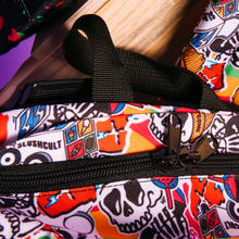 Close up of nylon carrying strap on the top of Acembly x SlushCult Backpack Collage/Splatter/Cups