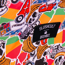 Close up of Acembly x SlushCult Backpack Collage/Splatter/Cups fabric and label