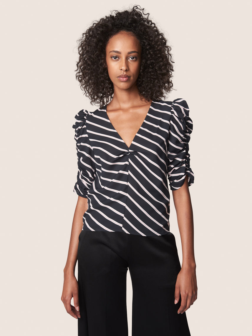 Statement shoulder blouse with v-neckline and ruched sleeves