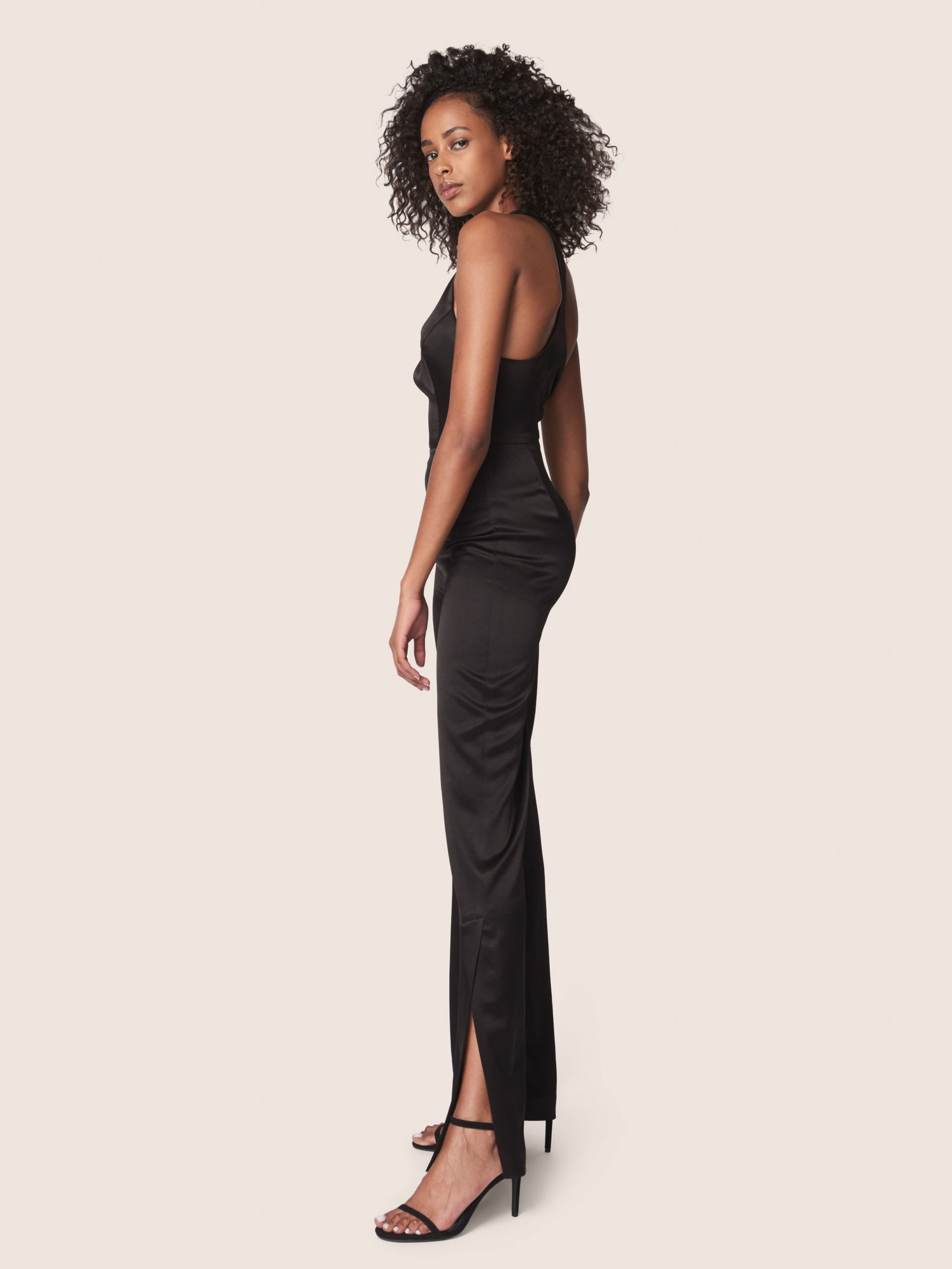 Black satin jumpsuit with deep v-neckline and racerback